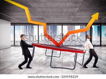 Businessmen bounce an arrow on a trampoline - stock photo