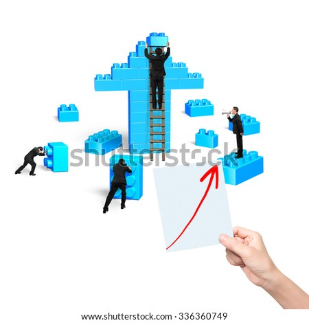 Businessmen building stack blocks in arrow up shape with one hand holding blueprint, isolated on white background. Teamwork concept. - stock photo