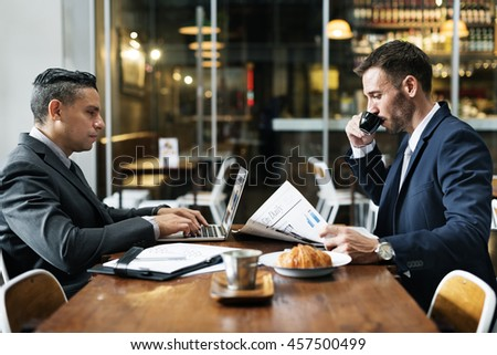 Businessmen Cafe Working Newspaper Concept - stock photo
