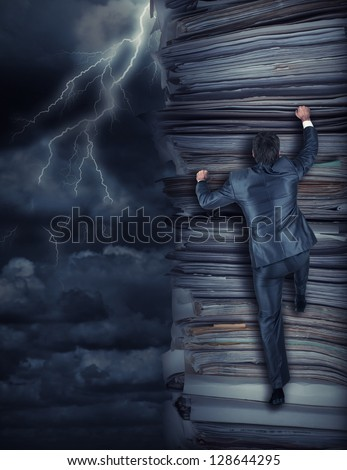 Businessmen climbing up a pile of documents at storm