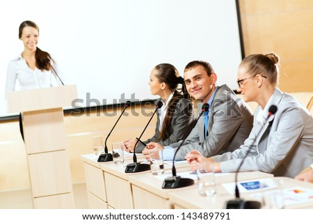 businessmen communicate at the conference, man looking at the camera - stock photo