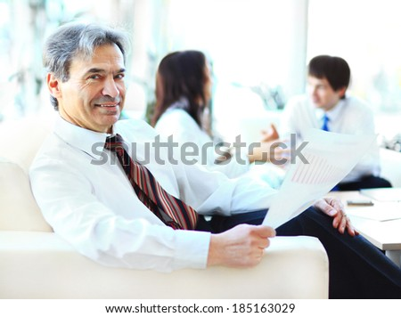Businessmen discuss the deal. - stock photo
