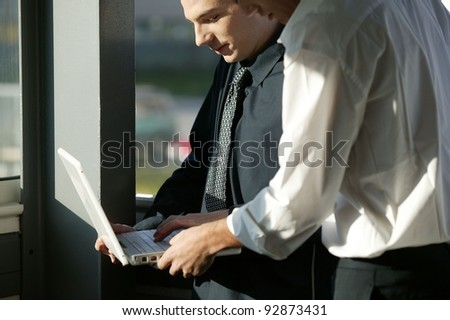 Businessmen discussing their business project - stock photo