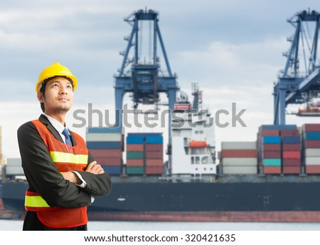 Businessmen engineering standing handsome smile in front of against cargo port looking away
