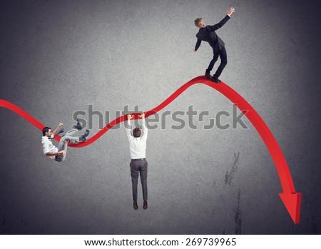 Businessmen falling down toward the economic crisis - stock photo