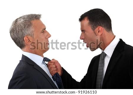 businessmen fighting - stock photo