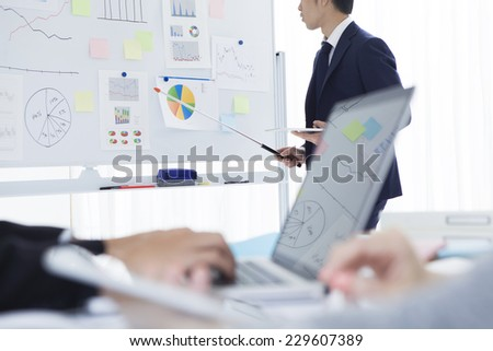 Businessmen for presentations using charts - stock photo