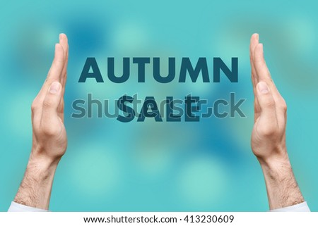 "Businessmen from both hands "" AUTUMN SALE "" writes - stock photo"