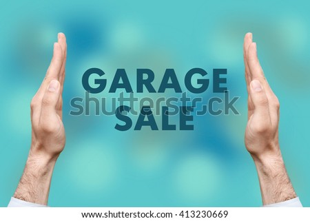"Businessmen from both hands "" GARAGE SALE "" writes - stock photo"