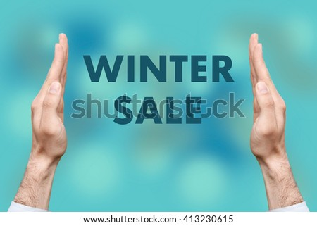 "Businessmen from both hands "" WINTER SALE "" writes - stock photo"