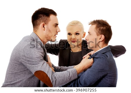 Businessmen getting into a fight woman trying to separate them - stock photo