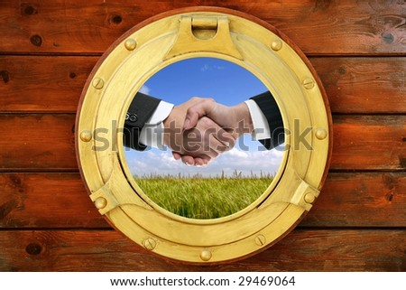 Businessmen green outdoor handshake view from boat round window [Photo Illustration]