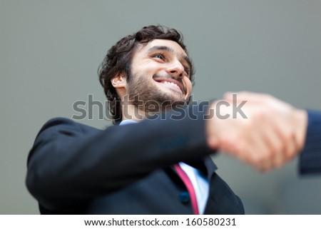Businessmen handshake - stock photo