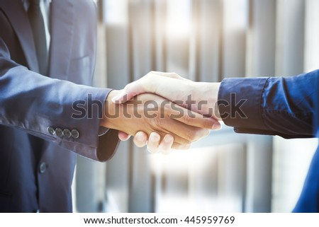 Businessmen handshake; success, dealing, greeting & business partner concepts - soft focus - stock photo