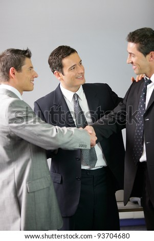 Businessmen handshaking - stock photo