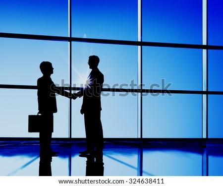 Businessmen Handshaking Contract Deal Business Concept - stock photo