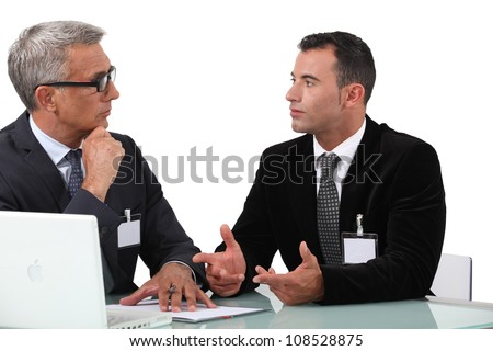 businessmen having a discussion - stock photo