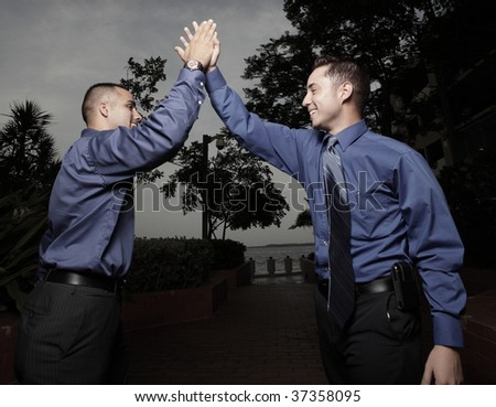 Businessmen highfiving each other