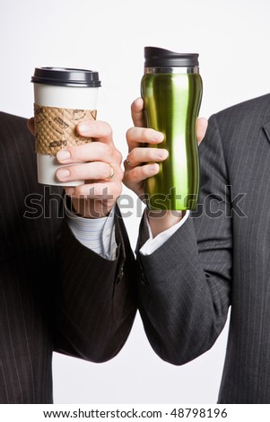 Businessmen holding coffee cups - stock photo