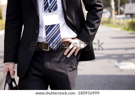 Businessmen holding his waist with his hands