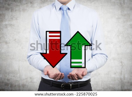 Businessmen holding two arrows 'up' and 'down'  - stock photo