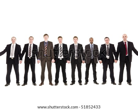 Businessmen in a row holding hands isolated on white background - stock photo