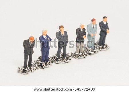 Businessmen in chains