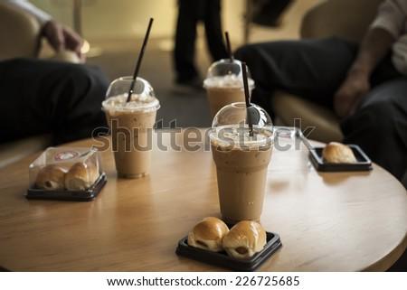 Businessmen in coffee break - stock photo