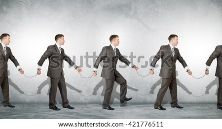 Businessmen in handcuffs arrested on grey background - stock photo