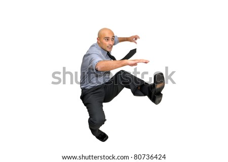 Businessmen jumping isolated in white - stock photo