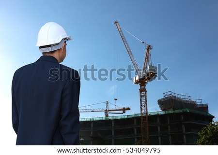 Businessmen look at a building site