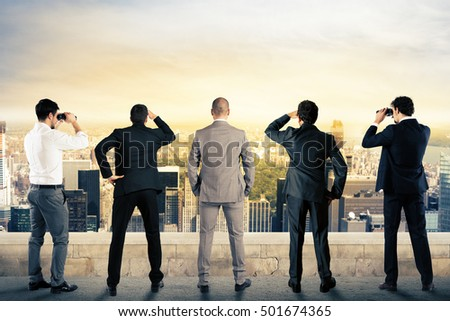 Businessmen looking to the future