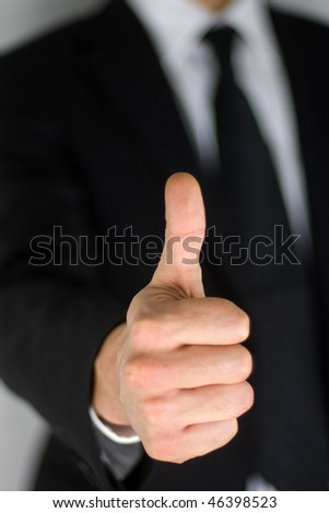 Businessmen making his thumb up saying OK isolated on white background.