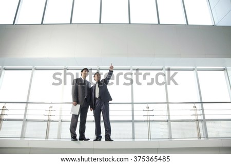 Businessmen Planning New Office - stock photo