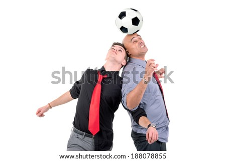 Businessmen playing soccer isolated in white - stock photo