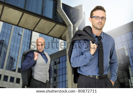 Businessmen posing in a business center - stock photo