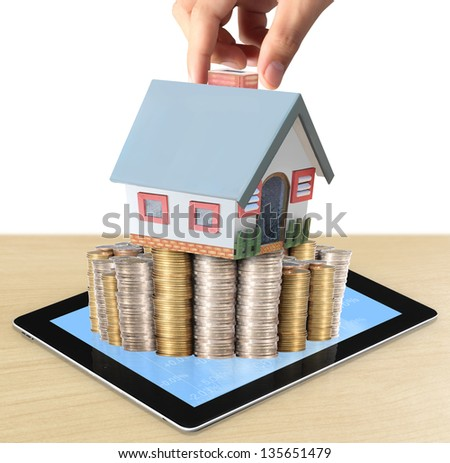businessmen Protect Your House in hand and shows tablet - stock photo