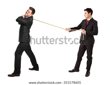 Businessmen pulling a rope - stock photo