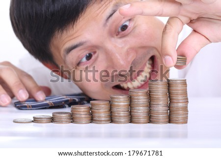 Businessmen put coin stack money for money growth concept