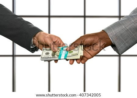 Businessmen's hands passing money bundle. Obtaining dollars on white background. Money rules the world. The path takes strange turns. - stock photo