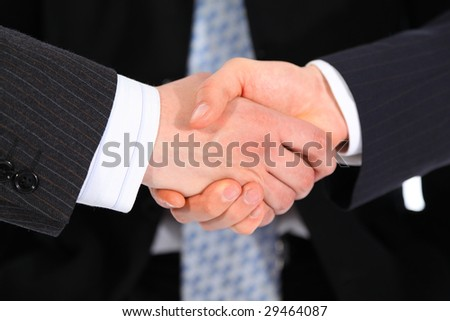 Businessmen`s handshake and tie on background
