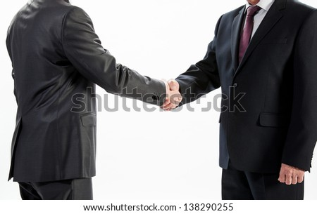 Businessmen shake hands isolated on white