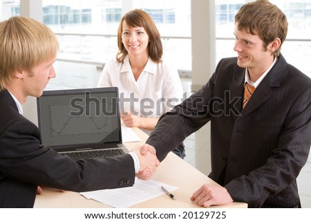 Businessmen shake their hands against the background of a woman - stock photo