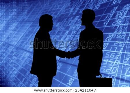 Businessmen shaking hands. - stock photo