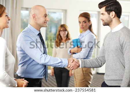 Businessmen shaking hands after closing the deal. - stock photo