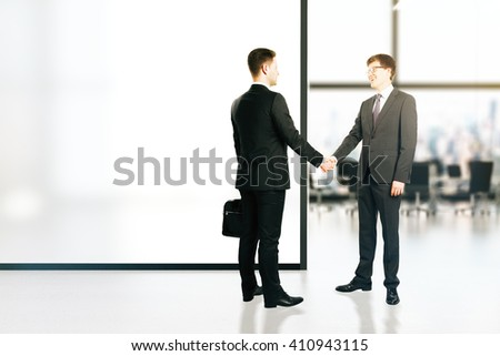 Businessmen shaking hands in conference room interior with blank banner. Mock up, 3D Rendering - stock photo
