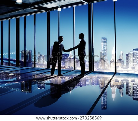 Businessmen Shaking Hands Indoors City As A Background Concept - stock photo