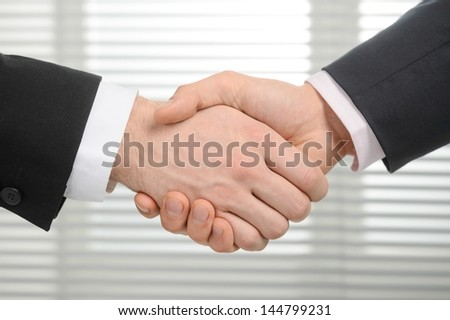 Businessmen shaking hands, isolated on background