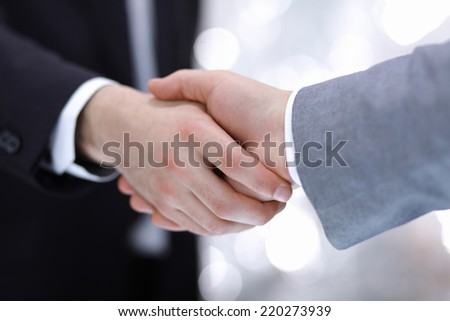 Businessmen shaking hands, isolated on white. - stock photo