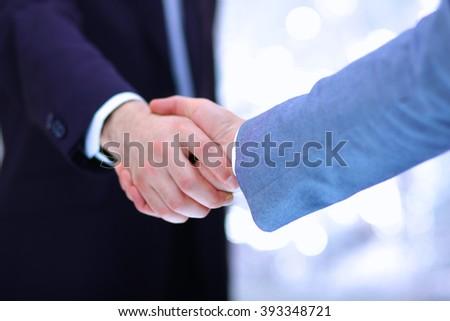 Businessmen shaking hands, isolated on white background - stock photo